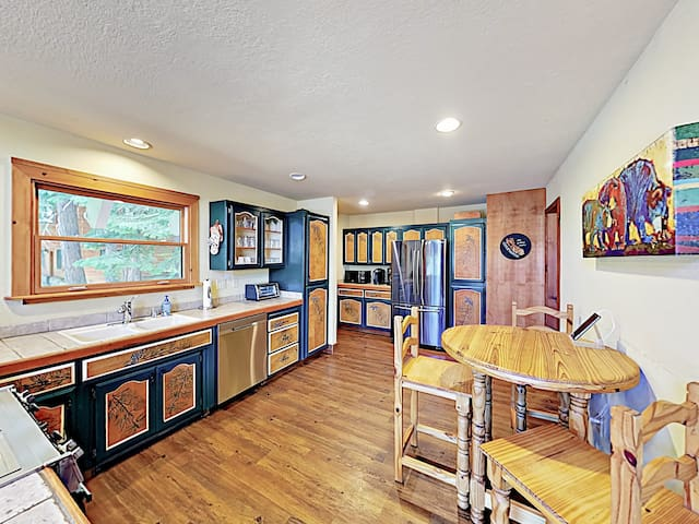 Whip up tasty meals in the well-equipped kitchen, featuring a full suite of appliances and plenty of counter space.