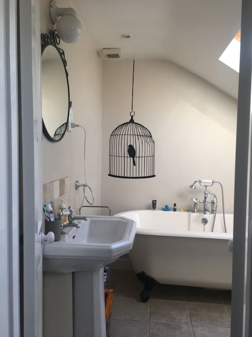 Master bedroom ensuite with bath and toilet