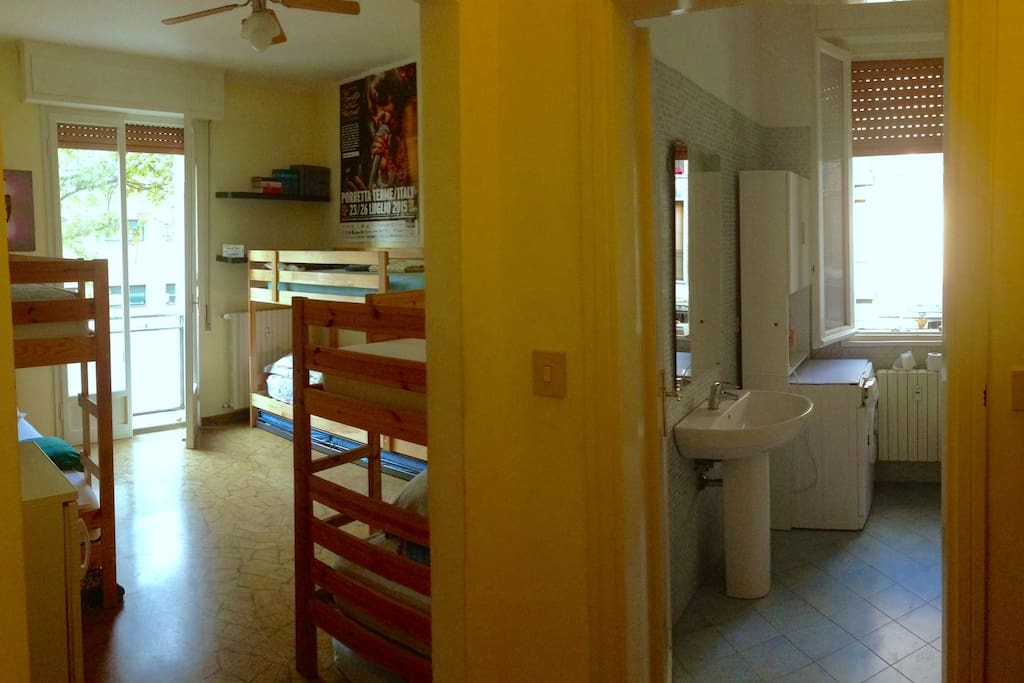 Panoramic view of bedroom and bathroom