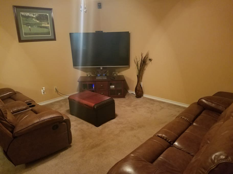 """Shared living room w/ 65"""" TV, 5G WiFi provided, couches have recliners in each end."""