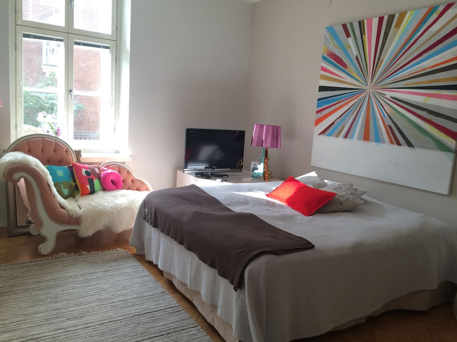 Double bedroom with king size bed. There is a connecting door to the single bedroom.