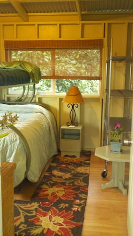 makai bedroom with a double and twin bunk, desk