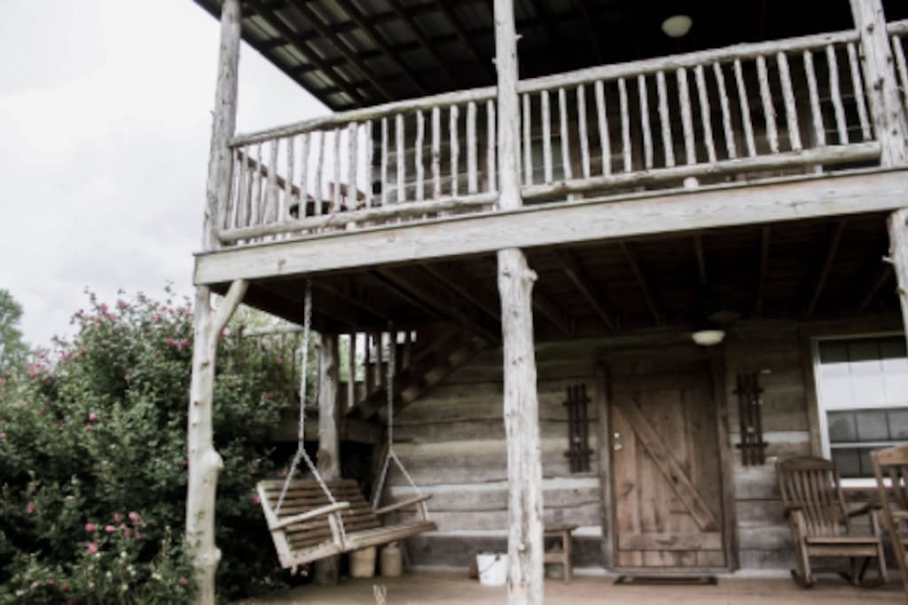 Two porches with rocking chairs and a swing to overlook the vines.