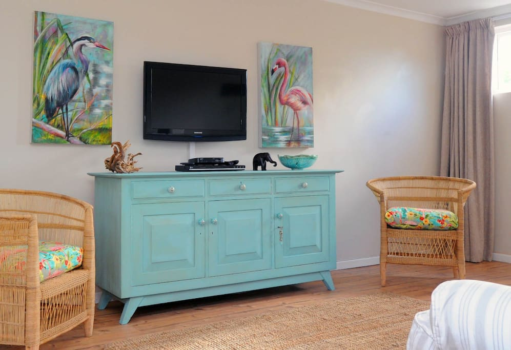 The decor is a vibrant mix of cool shades and vibrant colors