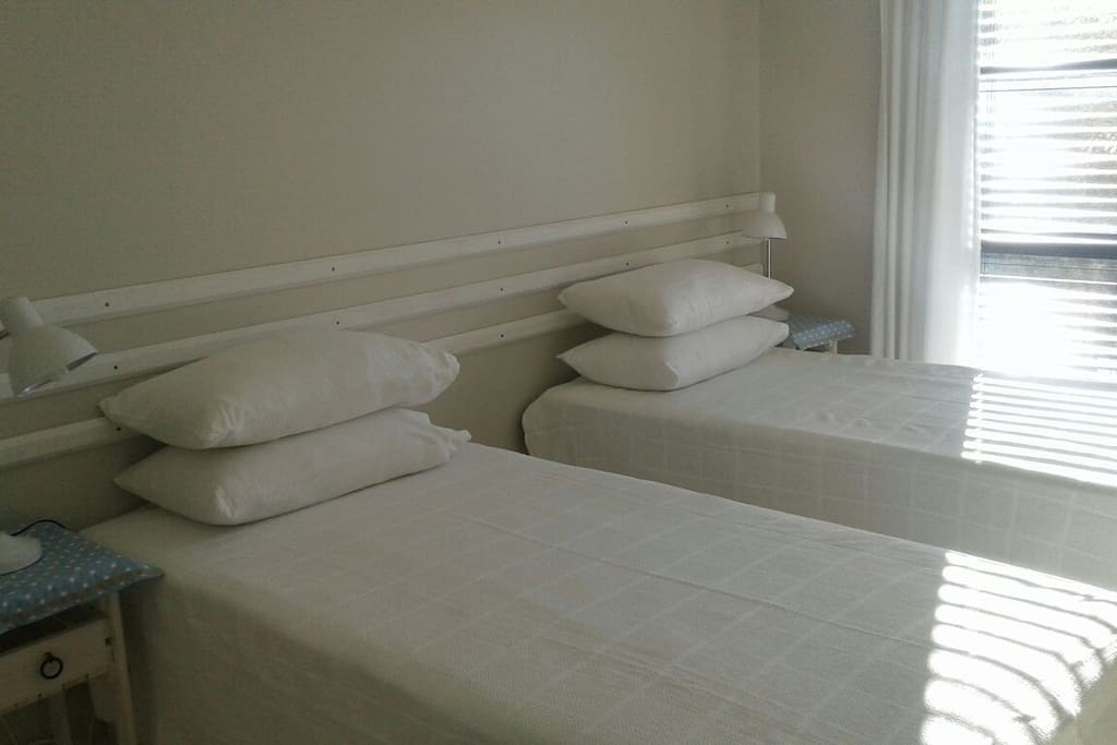 Main bedroom with two single beds which can be used as a king size bed