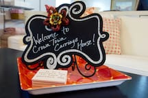 Charlotte, named after Queen Charlotte, is often referred to as The Queen City. You'll also hear it referred to as CLT, The QC, or Crown Town. We ran with the Crown Town theme for our carriage house. We want our space to be a jewel in the crown of the Queen City, and we look forward to welcoming you soon!