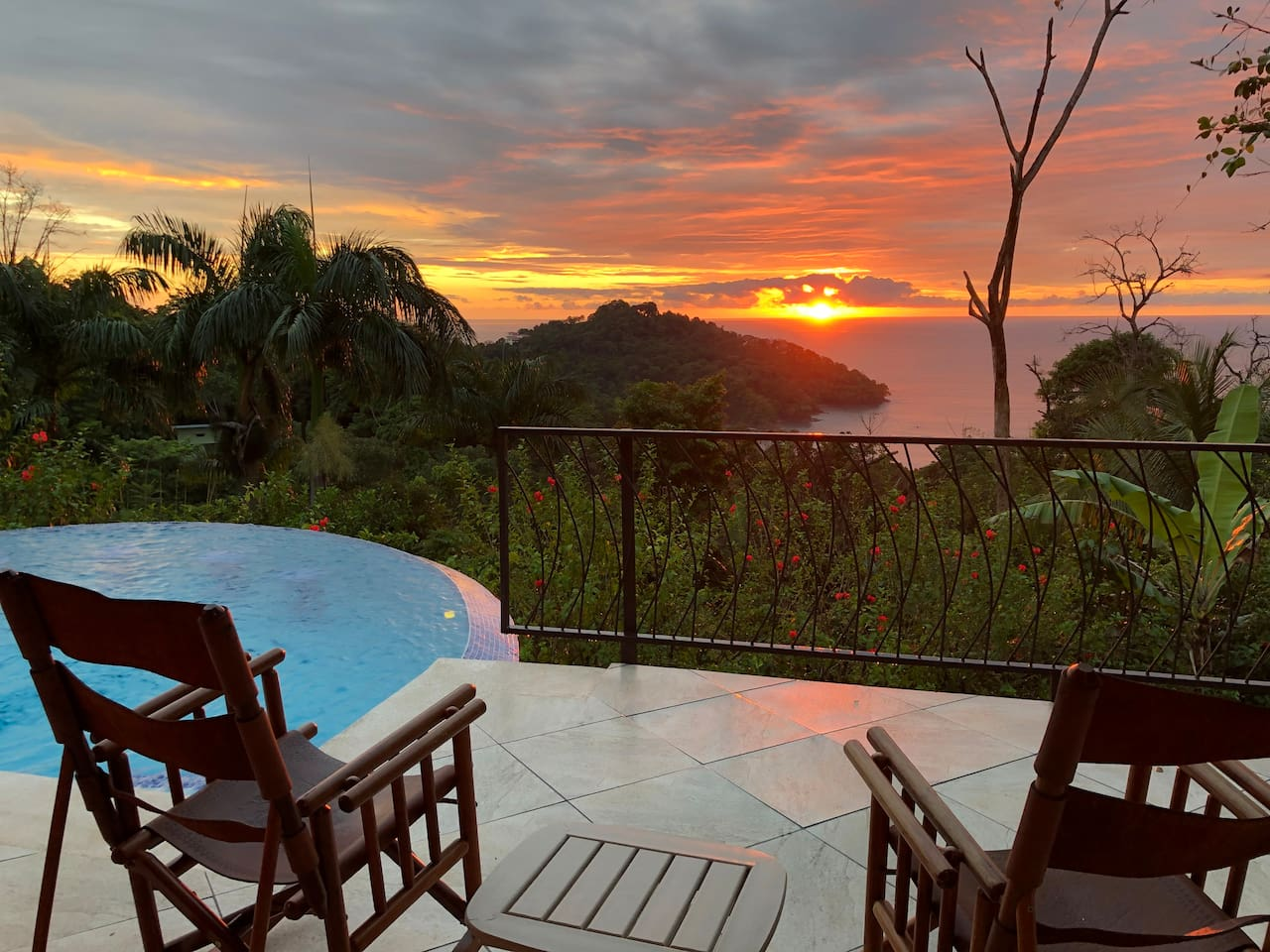 Your view and the infinity pool. Huge deck with 3 Lounge chairs and multiple rocking chairs