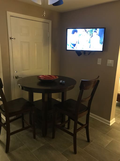 Private dining area with television.