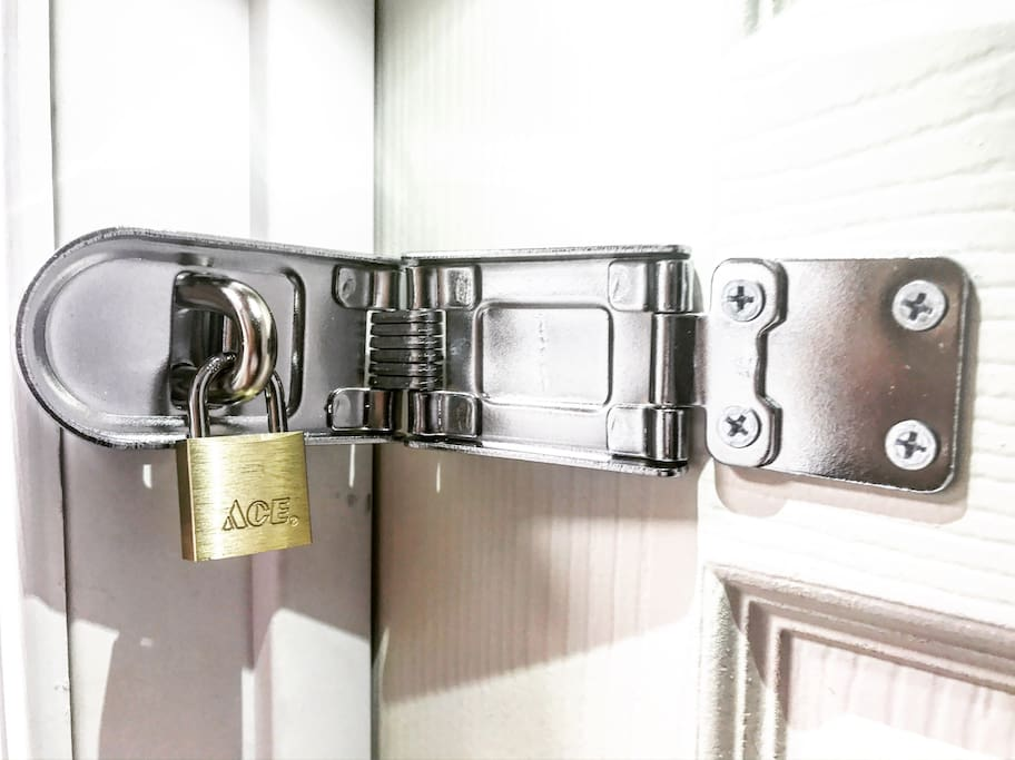 All Listings at 3522 W. Flournoy St. will contain an External Fixture on the Bedroom Door to which a Padlock can be attached.    (Note: Actual apparatus might differ slightly based on Style & Soze of Door)  In order to ensure 100% Safety & Security we will NOT provide a Lock.  Guests are encouraged to bring their own or they may purchase a Brand New MasterLock Combination Lock, on site, for a Small additional fee.