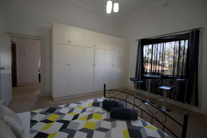 Bedroom 3, queen size bed and single size bed with ducted heating and cooling.