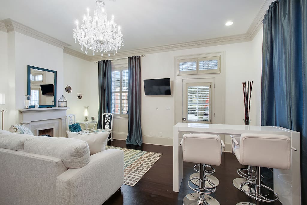 Enjoy this newly renovated unit with 12 ft. ceilings, with ornate molding and vintage chandeliers.