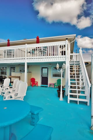 The Fisherman's Reef is a brightly decorated, ocean front condo that is a ground