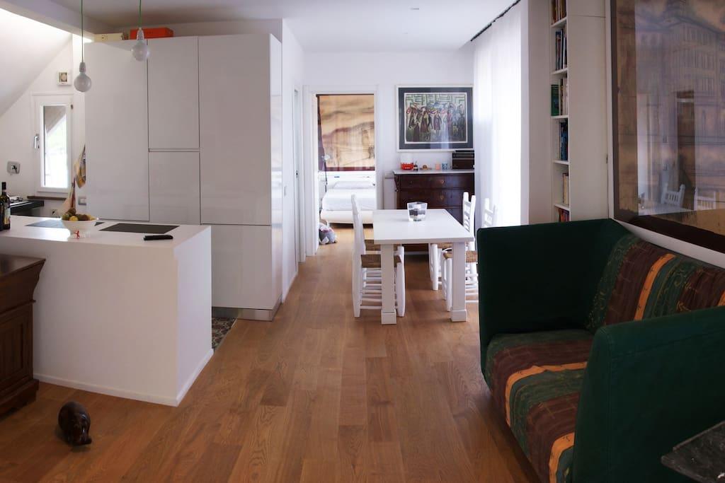 soggiorno, zona pranzo e cucina