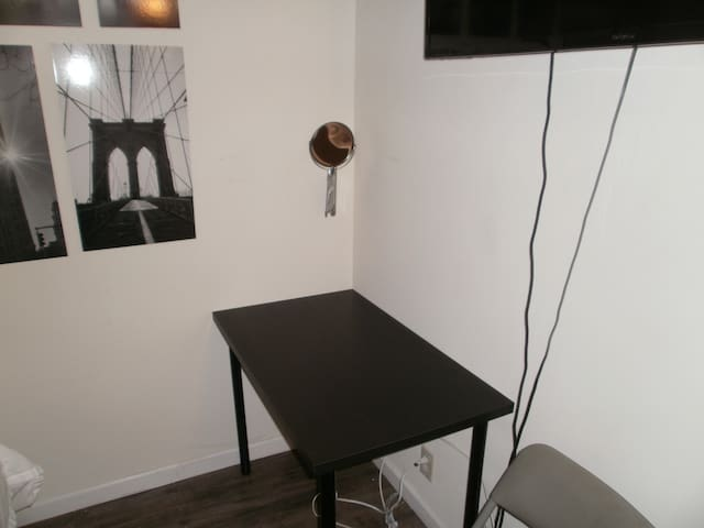 Small table/desk with makeup mirror.