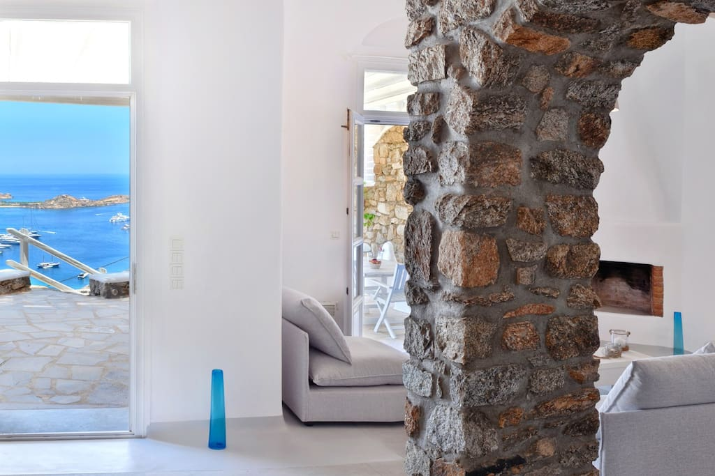 Cozy feeling in the living room with stone walls and white walls