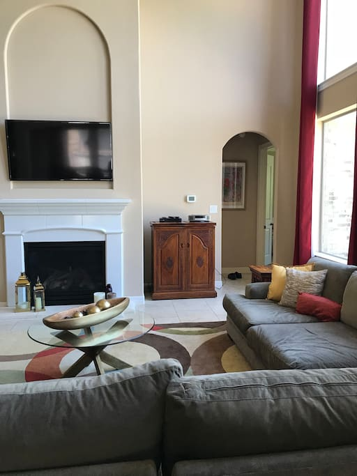 Common living area with fireplace and big screen Smart TV.