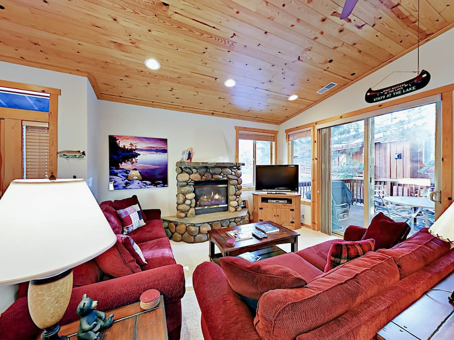 """Enjoy the warm ambiance of the gas fireplace with a stone hearth while you take in a movie on the 42"""" TV or play a game on the PlayStation."""