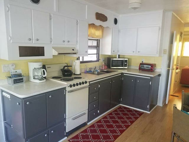 Fully equipped kitchen with everything you need to prepare great food!!! Plenty of storage space, pots, pans, plates, mugs, coffe pot, microwave and toaster oven...