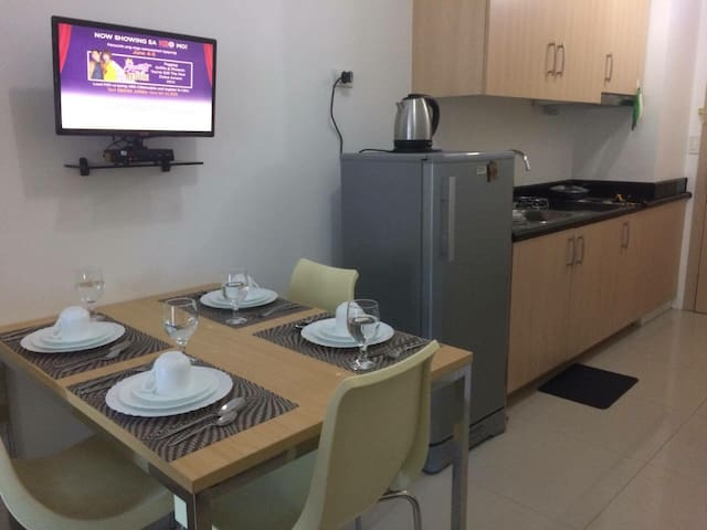 Kitchen and dining area with movable television screen