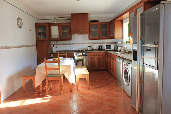 Kitchen with all the necessary amenities. Large fridge, oven, microwave, dishwasher and washing machine