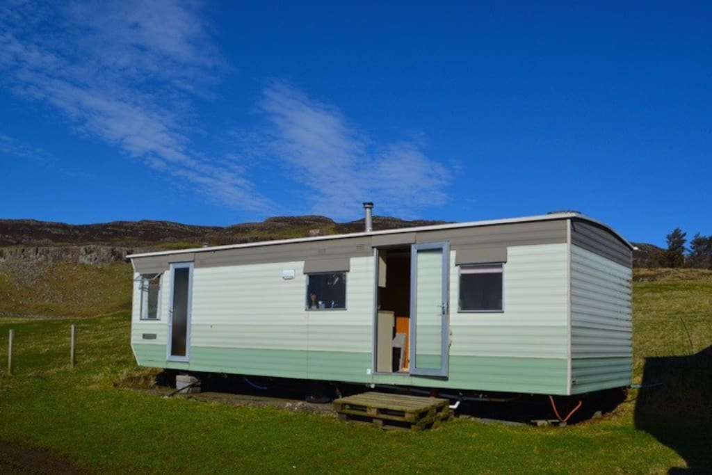 The caravan sits quietly near to the farm steadings.