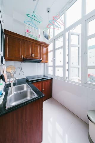 Fully equipped kitchen with massive window