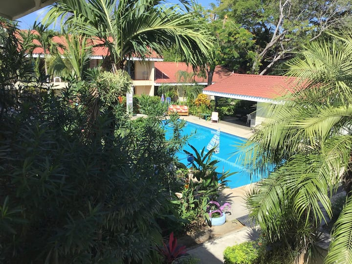 Newly remodeled poolside condo block from beach