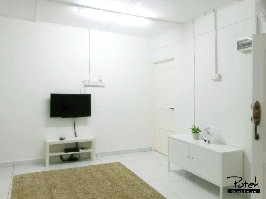 Living area with TV and Astro NJOI satellite channel.