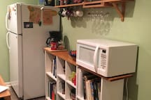 Microwave, coffee pot, and all the cookbooks you can handle!