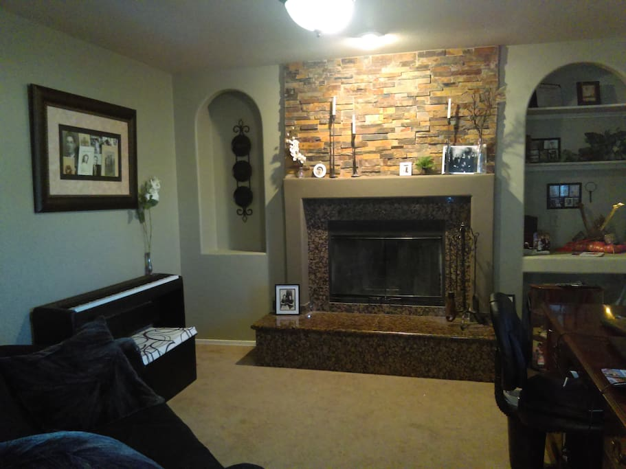Office that is a part of Master Bedroom. Digital piano, couch, and executive desk. Renovated in 2017.