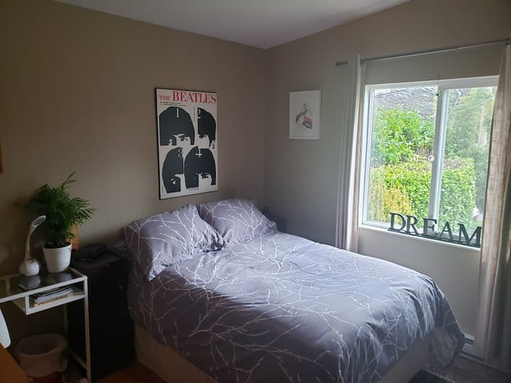 Bright bedroom with views of Mt Doug