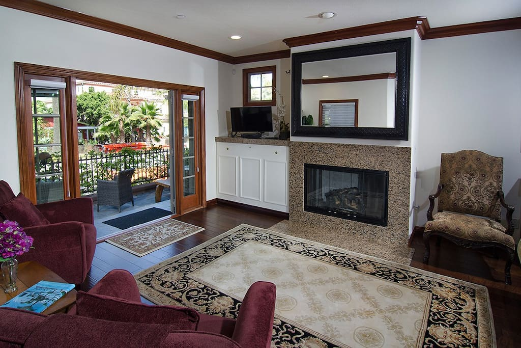 Living room with gas fireplace, french doors to patio.