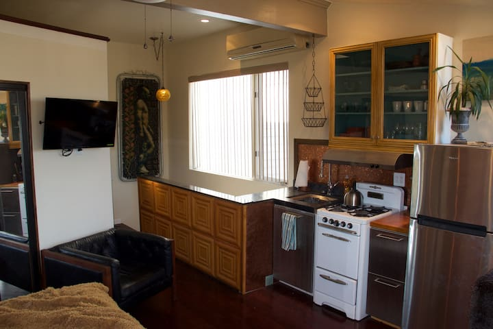 Cable TV with DVD player and remote, vintage gas stove in perfect condition, large stainless steel fridge with freezer and all the kitchen amenities you'd need for a getaway!