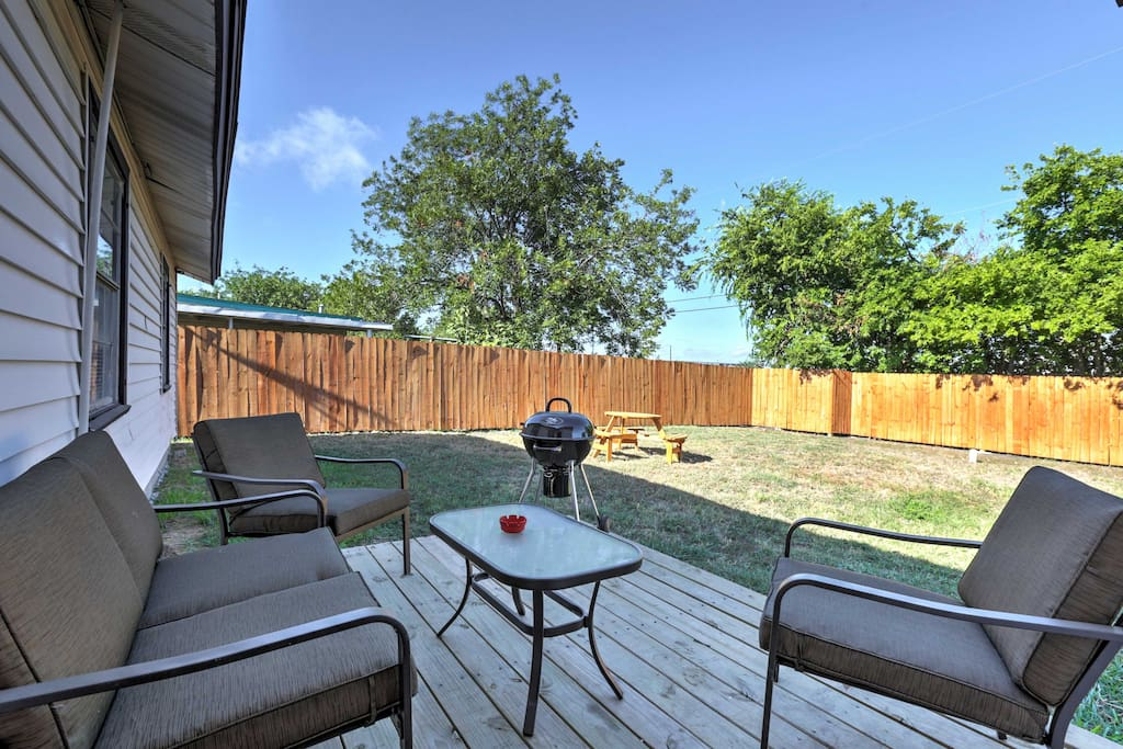 Relish in the large, fenced-in backyard that offers a deck, grill, patio furniture, and a picnic table.