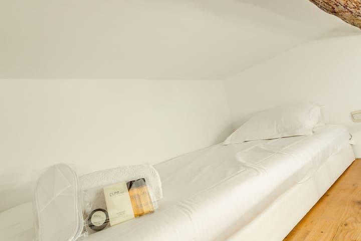 Single bed on the mezzanine