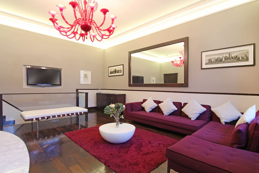 The very spacious, bright Lounge and Dining Area with recessed flat screen TV