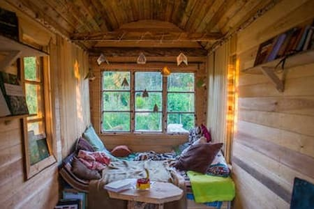 A tiny home with view over lush garden