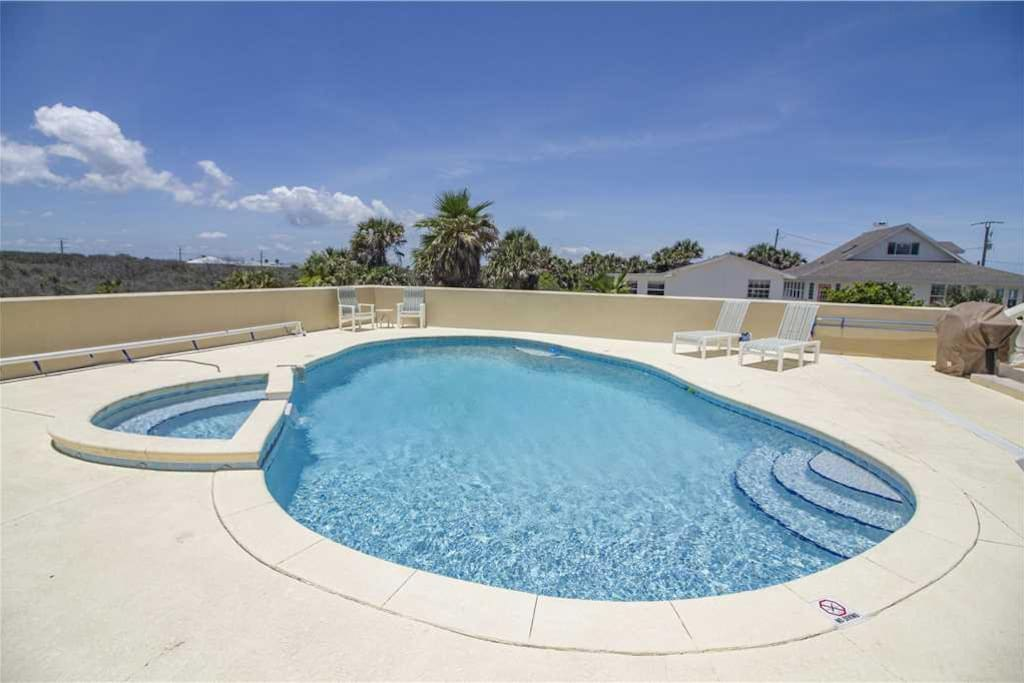 Spend an afternoon with the whole gang in the pool! - It's irresistible -- sparkling clear water, a spotless sun shelf, and the b