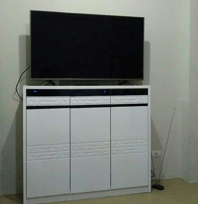 50-inch. Smart TV with multi-purpose rack