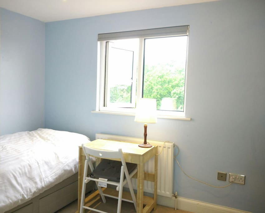 Room 1.  bright room with a window overlooking the garden with a good view of Muswell Hill.Has new bed,drawers, clothes rail, desk and chair with desk lamp