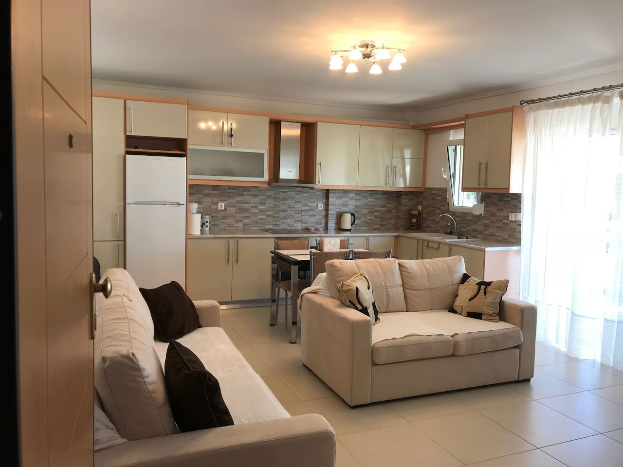 Kitchen and dinning area with living room