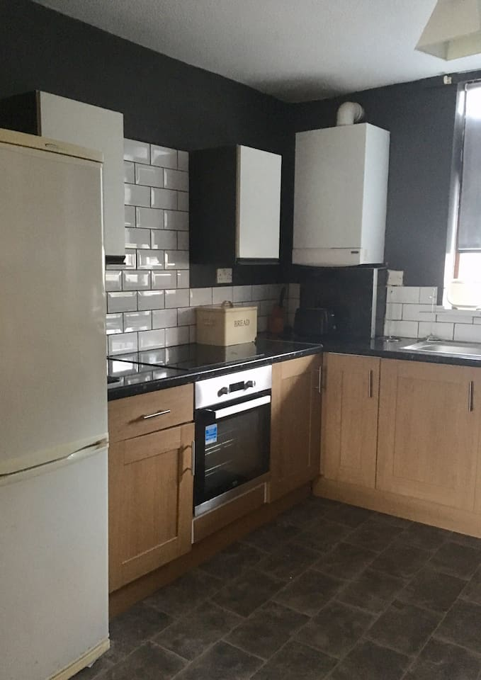 Kitchen, comprises washing machine, hob & oven, fridge/freezer, combi boiler, fitted cupboards.