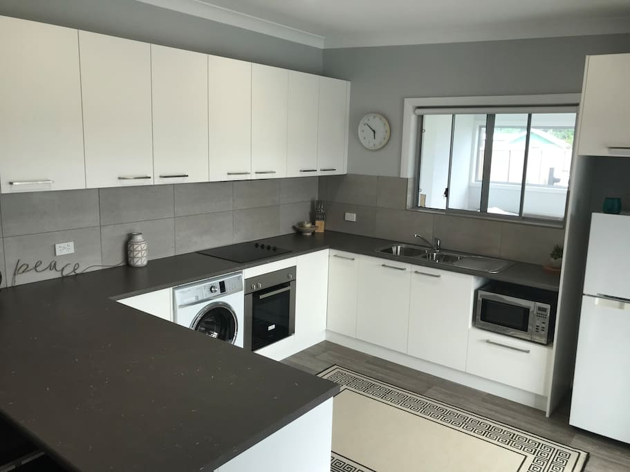 Large kitchen with plenty of storage and work space.  And a brand new washing machine.