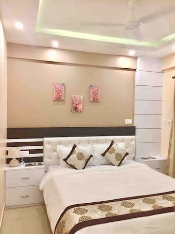 Bedroom 1 , fully interior designed with queen bed , AC , ceiling fan , tray lighting and sparkling clean linen / blanket / pillows - for two.