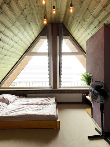 cozy attic room with west-facing balcony in Werne