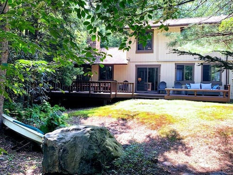 Stream-front family home in stunning Lake Naomi