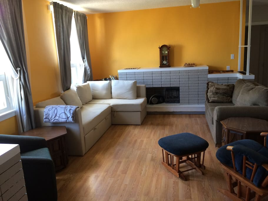 Living room. White couch can open into an extra queen size bed. Comfortable foamy and sheets for on top available.