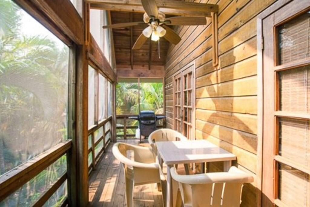 You arrive first at the screened-in veranda