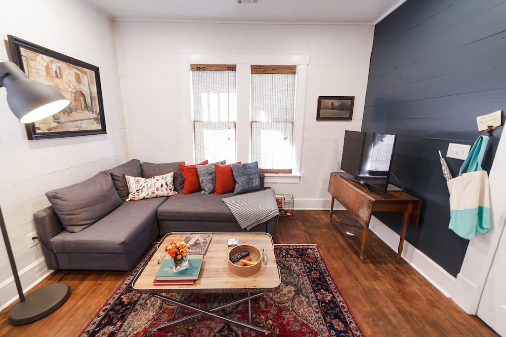 Eclectic decor set in a cozy living space with a pull-out sofa bed.