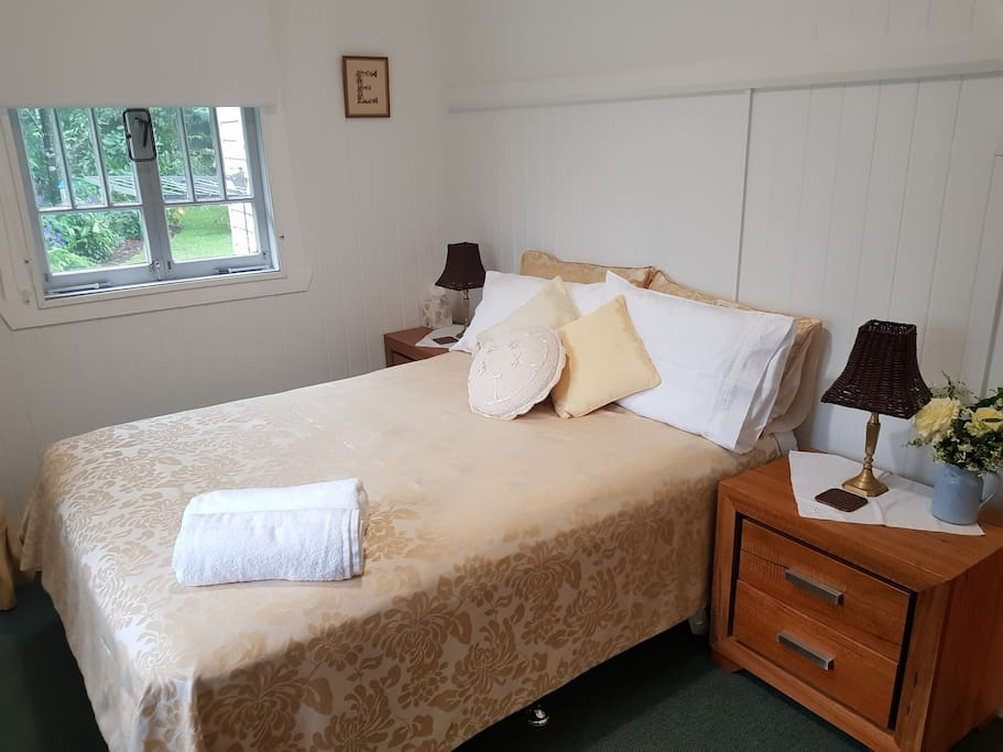 This is the second guest bedroom with a double bed. Tranquil views from windows on two sides.  Bliss